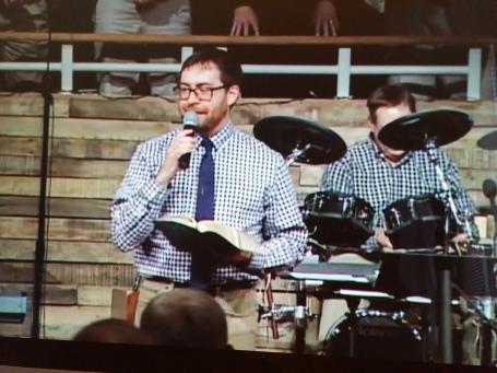 John w Bible and mic1 copy.jpg